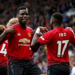 Manchester United's Fred celebrates scoring their first goal with Paul Pogba.