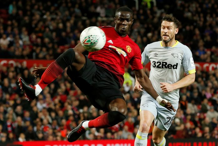 Manchester United's Eric Bailly in action with Derby County's David Nugent.