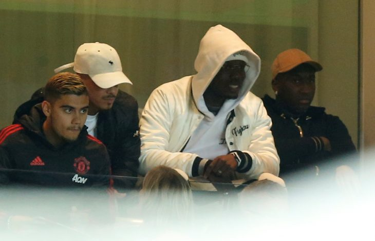Andreas Pereira and Paul Pogba watch the match from the stands.