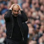 Man City manager Pep Guardiola reacts during the match.