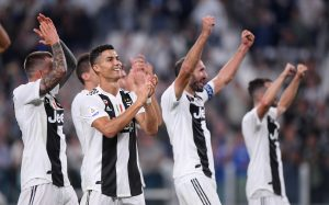 Juventus' Cristiano Ronaldo applauds fans after the match with team mates.