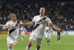 LA Galaxy forward Zlatan Ibrahimovic (9) celebrates with defender Rolf Feltscher (25).