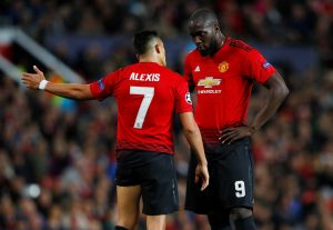Manchester United's Romelu Lukaku speaks with Alexis Sanchez.