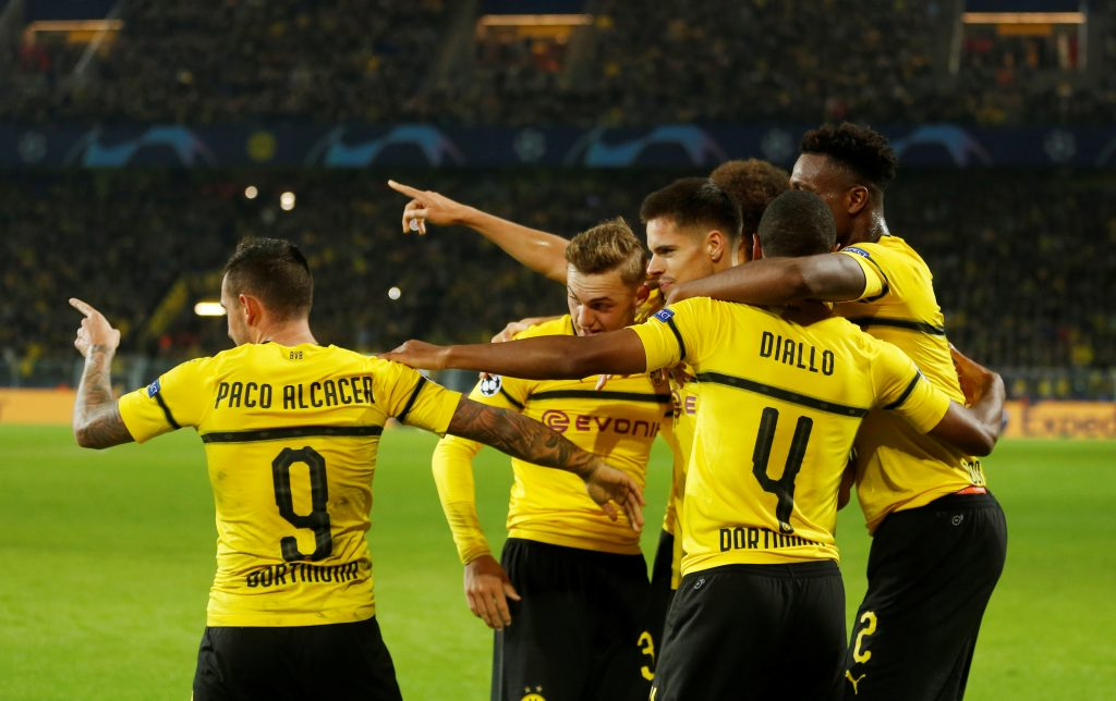 Borussia Dortmund's Paco Alcacer celebrates scoring their second goal with Abdou Diallo and team mates.