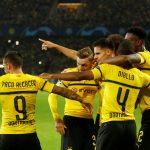 Borussia Dortmund's Paco Alcacer celebrates scoring their second goal with Abdou Diallo and team mates.