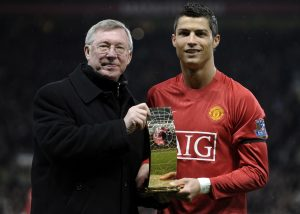 Cristiano Ronaldo receives the World Footballer of the Year Award from Sir Alex Ferguson.