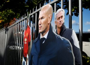 Cardboard cutouts of Jose Mourinho and Zinedine Zidane outside the stadium.