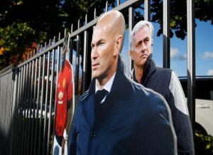 Cardboard cutouts of Jose Mourinho and Zinedine Zidane outside the stadium.