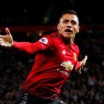 Manchester United's Alexis Sanchez celebrates scoring their third goal.