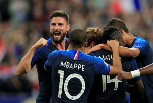 France's Antoine Griezmann celebrates scoring their second goal with teammates.