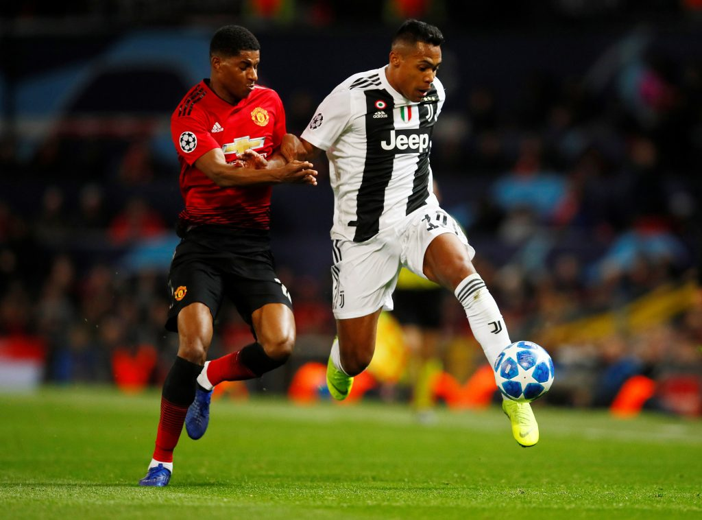 Juventus' Alex Sandro in action with Manchester United's Marcus Rashford.