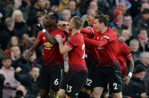 Manchester United's Paul Pogba celebrates scoring their first goal with teammates.