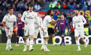Real Madrid's Marcelo celebrates scoring their first goal with Lucas Vazquez and team mates.