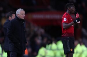 Jose Mourinho looks on alongside Paul Pogba.