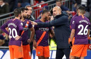 Man City manager Pep Guardiola with Bernardo Silva, Sergio Aguero and team mates.