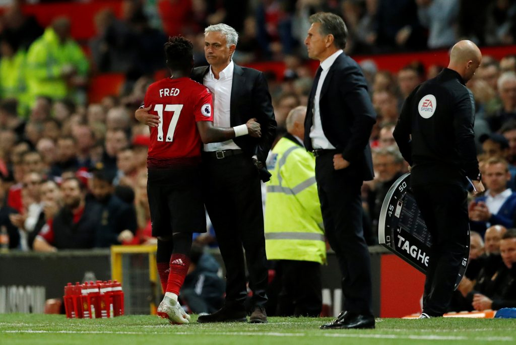 Manchester United's Fred with Jose Mourinho after being substituted.