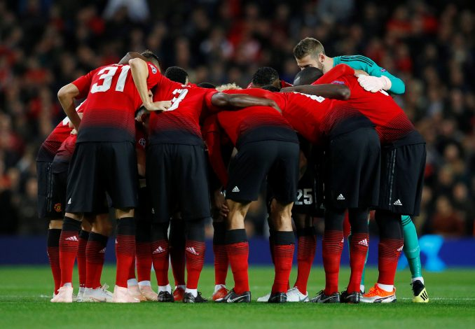 Manchester United team huddle before the match.