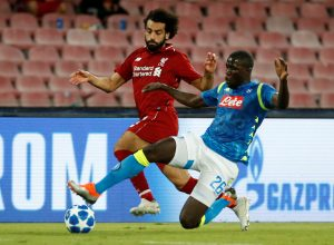 Liverpool's Mohamed Salah in action with Napoli's Kalidou Koulibaly.