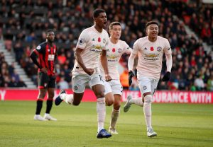 Manchester United's Marcus Rashford celebrates scoring their second goal with Jesse Lingard and Ander Herrera.