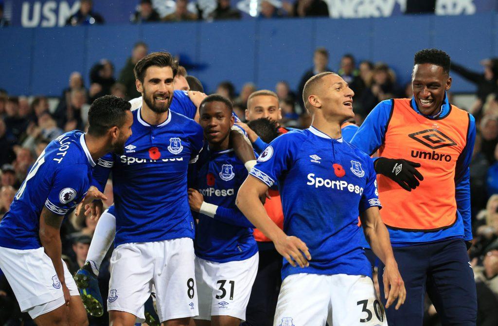Everton's Richarlison celebrates scoring their third goal with teammates.