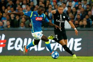 Napoli's Kalidou Koulibaly in action with PSG's Kylian Mbappe.