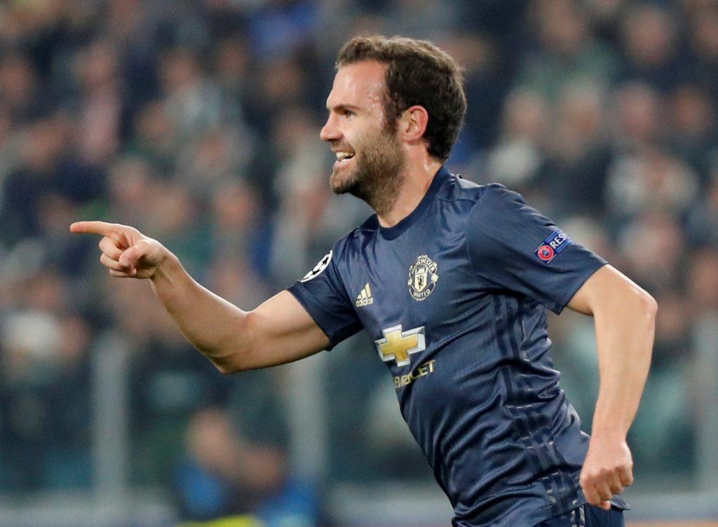 Manchester United's Juan Mata celebrates scoring their first goal.