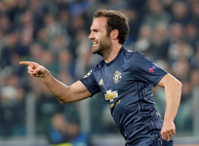 Manchester United's Juan Mata celebrates scoring their first goal.