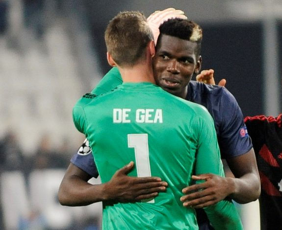 Manchester United's David de Gea and Paul Pogba celebrate after the match.