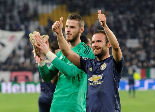Manchester United's David de Gea and Juan Mata celebrate after the match.