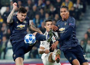 Juventus' Cristiano Ronaldo in action with Manchester United's Victor Lindelof and Chris Smalling.