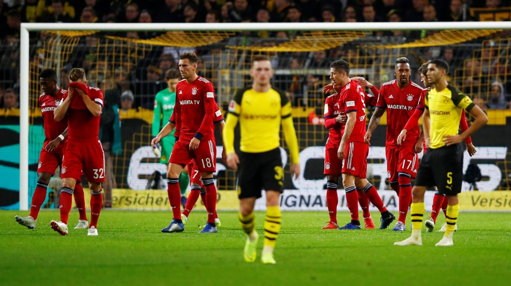Soccer Football - Bundesliga - Borussia Dortmund v Bayern Munich - Signal Iduna Park, Dortmund, Germany - November 10, 2018  Bayern Munich's Robert Lewandowski celebrates scoring their first goal with team mates     REUTERS/Wolfgang Rattay  DFL regulations prohibit any use of photographs as image sequences and/or quasi-video - RC1CB1F60EA0