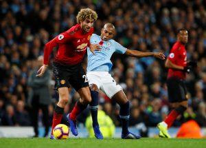 Manchester United's Marouane Fellaini in action with Man City's Fernandinho.
