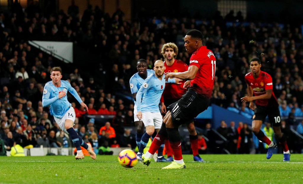 Manchester United's Anthony Martial scores their first goal from the penalty spot.