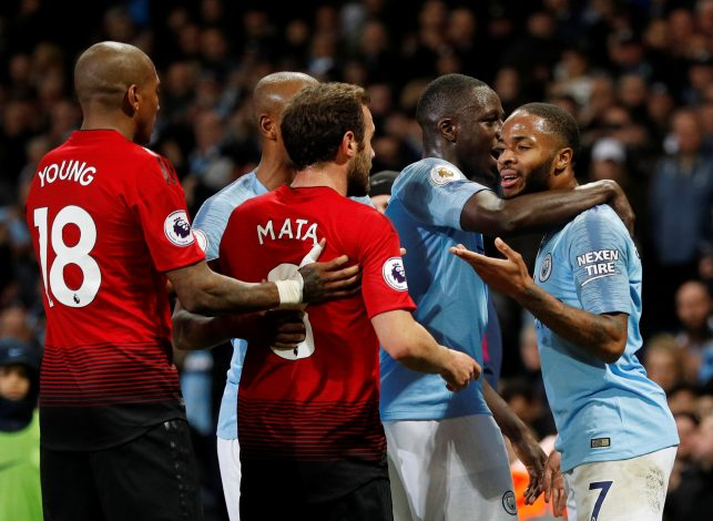 Man City's Raheem Sterling clashes with Manchester United's Juan Mata.