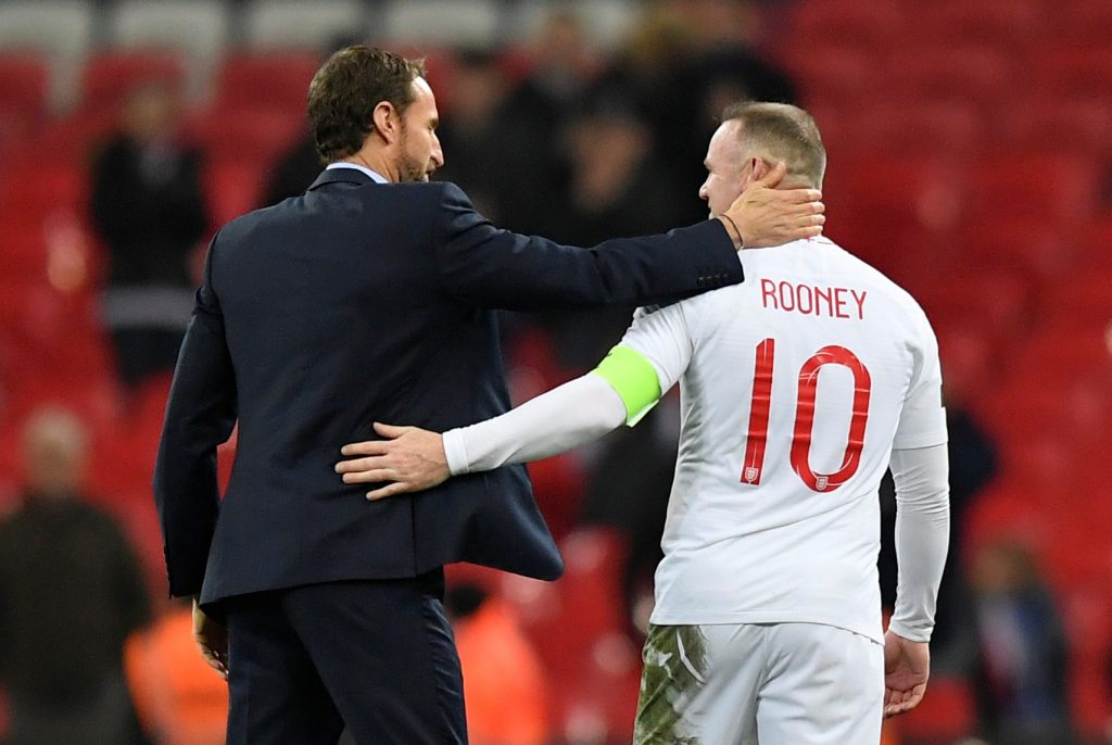 England's Wayne Rooney with manager Gareth Southgate at the end of the match.