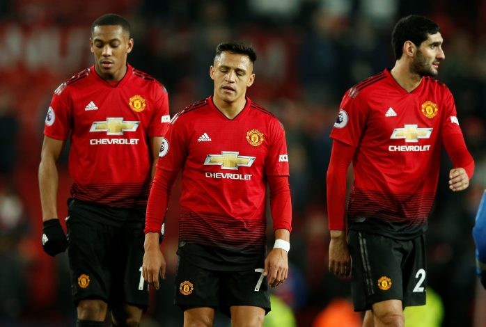 Manchester United's Anthony Martial, Alexis Sanchez and Marouane Fellaini look dejected after the match.