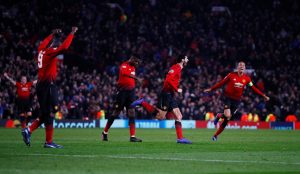 Manchester United's Marouane Fellaini celebrates scoring their first goal.