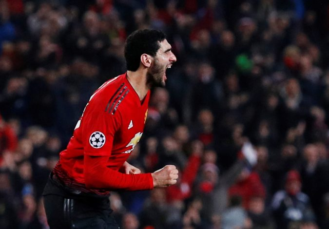 Manchester United's Marouane Fellaini celebrates scoring their first goal.