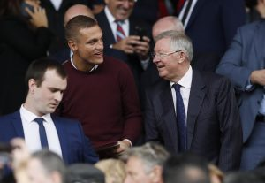 Sir Alex Ferguson and Nemanja Vidic in the stands.