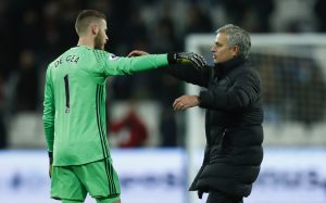 Manchester United manager Jose Mourinho and David De Gea celebrate after the game.