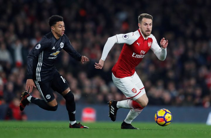 Arsenal's Aaron Ramsey in action with Manchester United's Jesse Lingard.