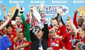 MUFC manager Sir Alex Ferguson (C) celebrates winning the Barclays Premier League.