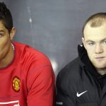 Manchester United's Cristiano Ronaldo and Wayne Rooney wait on the substitutes bench.
