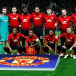 Man Utd players pose for a team group photo before the match.