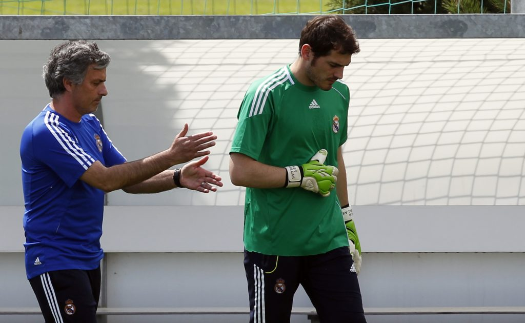 Real Madrid's coach Jose Mourinho (L) gestures beside goalkeeper and captain Iker Casillas during their team's training session.