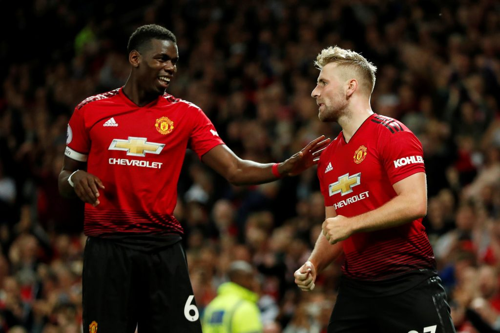 Manchester United's Luke Shaw celebrates scoring their second goal with Paul Pogba.