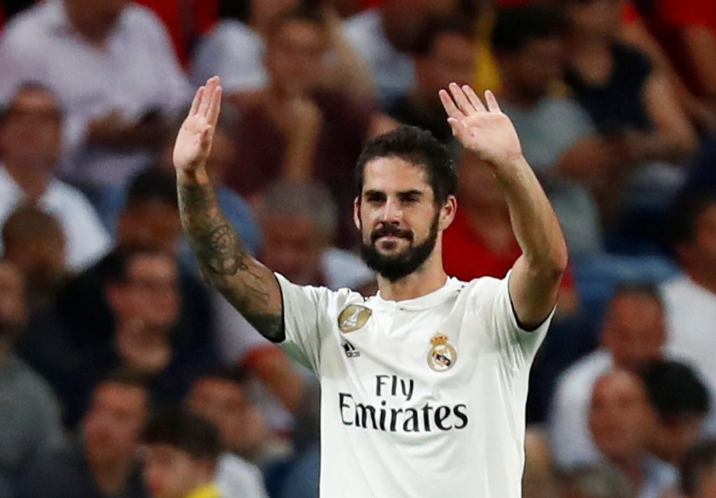 Real Madrid's Isco celebrates scoring their first goal.