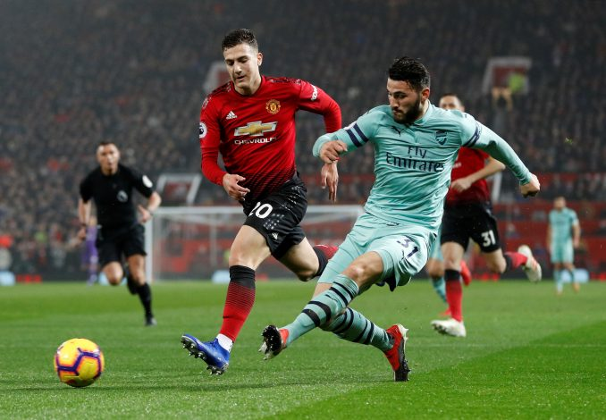 Arsenal's Sead Kolasinac in action with Diogo Dalot.