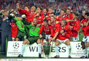 Manchester team with the Champions League trophy.