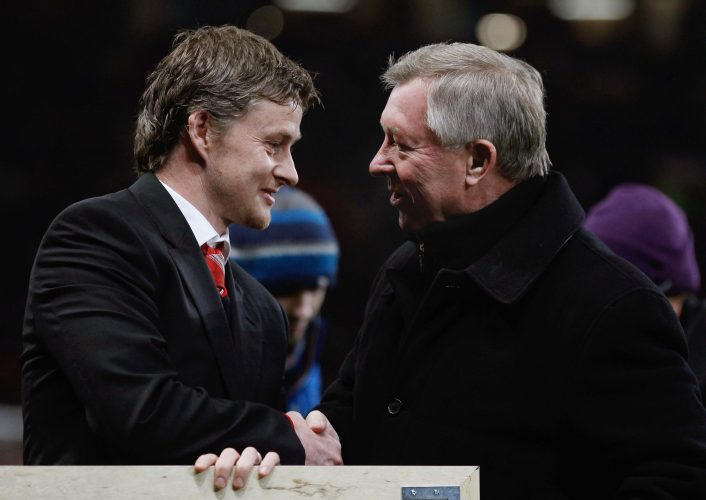 Sir Alex Ferguson (R) and Ole Gunnar Solskjaer shakes hands after a presentation to Solskjaer before the match.
